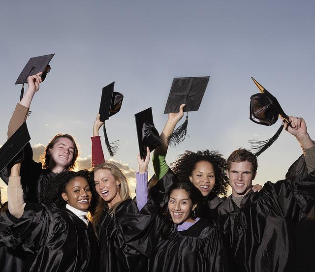 a mixed group of graduates celebrate